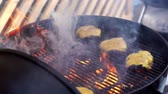 Cooking burger with cheese on open fire close-up in the fresh air. Grilled beef for hamburgers grilled on the pan and put the cheese on top. Meat for burgers is grilled on the grill and cheese.