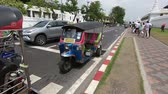 famous : Bangkok, Thailand - March 6, 2018 : Tuk Tuk is parking in front of Wat Phra Kaeo or Grand Palace, Bangkok, Thailand