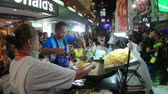 khaosan : Bangkok, Thailand - April 13, 2018 : Street food restaurant at Khao San road in Songkran day festival Stock Footage