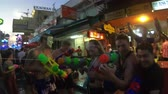 khaosan : Bangkok, Thailand - April 13, 2018 : People take part in water battles on street during Songkran festival at Khao San road Stock Footage