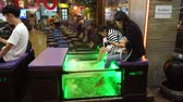 педикюр : Bangkok, Thailand - May 3, 2018 : A lady is in a spa fish at Yaowarat Road in Bangkoks Chinatown district Стоковые видеозаписи