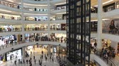 twin : Kuala Lumpur, Malaysia - July 17, 2018 : Time lapse video of interior of Suria KLCC. a modern. luxury shopping mall at the base of the Petronas Towers. in Kuala Lumpur Stock Footage