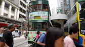 sétálóutca : Hong Kong, China - August 15, 2018 : Busy pedestrian crossing and tram arrival at station Stock mozgókép