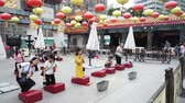 ibadet : Hong Kong, China - August 15, 2018 : People praying at the main altar in Wong Tai Sin Temple in Kowloon in Hong Kong Stok Video