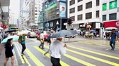 Hong Kong, China - August 15, 2018 : Pedestrians crossing zebra crossing at busy street Stok Video