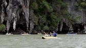 Phang Nga, Thailand - June 1, 2018 : An unidentified tourists kayaking among limestone islands