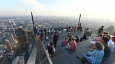 skywalk : Bangkok, Thailand - November 21, 2018 : Time lapse of people with 360 degree panoramic views on 78th floor at King Power Mahanakhon building rooftop Stock Footage