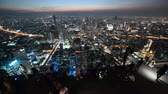 skywalk : Bangkok, Thailand - November 21, 2018 : People with night 360 degree panoramic views on 78th floor at King Power Mahanakhon building rooftop Stock Footage