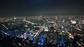 skywalk : Bangkok, Thailand - November 21, 2018 : Tourist with night 360 degree panoramic views on 78th floor at King Power Mahanakhon building rooftop Stock Footage