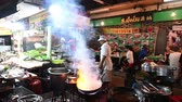 Bangkok, Thailand - November 24, 2018 : Slow motion fire of chef cooks food at a street-side restaurant in Chinatown