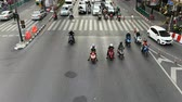 Bangkok, Thailand - November 23, 2018 : Time lapse view of Motorcycles, scooters and mopeds traffic at busy intersection in Bangkok Stok Video