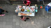 купец : Bangkok, Thailand - December 11, 2018 : Top view of unidentified vendors prepare food at a street side restaurant Стоковые видеозаписи