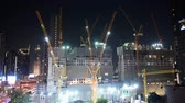 Bangkok, Thailand - December 18, 2018 : Night time lapse of working tower cranes at construction site 動画素材