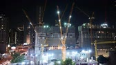 Bangkok, Thailand - December 18, 2018 : Night time lapse of tower cranes at construction site 動画素材