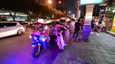 çubuk : Bangkok, Thailand - December 22, 2018 : Tuk tuk takes tourists at Talad Rod Fai in Bangkok