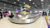 Bangkok, Thailand - January 11, 2019 : Time lapse of baggage conveyor belt in the Suvarnabhumi Airport carrying the passenger luggage