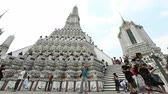 tanrılar : Bangkok, Thailand - January 7, 2019 : Time lapse view of tourist walking central pagoda at Wat Arun