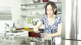přípravě : Asian girl in her 30s in her modern kitchen