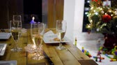 champanhe : sparkling wine champagne in front of chimney during christmas with tree Stock Footage