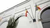 two belgian flags flying outside