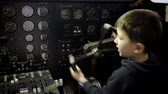 кокпит : kid driving inside a plane pilot with a the instruments