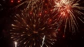 gwiazda : Bright volleys of fireworks in the night sky. City holiday