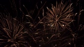 明けましておめでとうございます : Bright volleys of fireworks in the night sky. City holiday