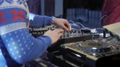 boates : DJ plays on stage in winter. open air at the winter festival