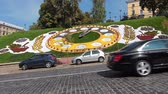 clock : traffic near real flower clock in center of Kiev