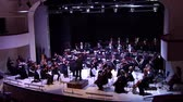 teatral : DNIPRO, UKRAINE - FEBRUARY 15, 2018: Members of the Symphonic Orchestra - main conductor Natalia Ponomarchuk perform Romanian Rhapsody by George Enescu at the Philharmonic.