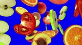 vegetal : Round slices of fruits fall from the top on blue screen, seamless loop, CG