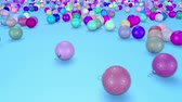 brinquedos : christmas balls fall crumble to the surface with depth of field. 3d animation for new year compositions or background. multicolor