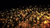shallow depth field : gold particles in liquid float and glisten. Background with glittering golden particles depth of field and bokeh. Luma matte to cut out glowing particles for holiday presentations. 4k 3d animation. 9