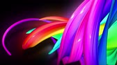 nastri colorati : 3d animation stream of colored ribbons fly on black background with neon light. Rainbow gradient on the flow of stripes. Luma matte is included as alpha channel. 4k motion graphics with copy space. 18