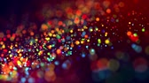 abundante : multicolored particles like confetti or spangles float in a viscous liquid and glitter in the light with depth of field. 3d abstract animation of particles in 4k. luma matte as the alpha channel. 11