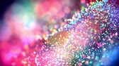evolução : multicolored particles like confetti or spangles float in a viscous liquid and glitter in the light with depth of field. 3d abstract animation of particles in 4k. luma matte as the alpha channel. 40