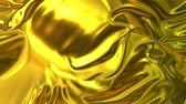 draperie : Gold silky fabric forms beautiful folds in the air in slow motion. 4k 3D animation of wavy surface forms ripples like in fluid surface and the folds like in tissue. Animated texture. Vidéos Libres De Droits