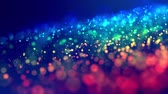 fantasztikus : fantastic festive abstract background of glitter magic multicolor particles fly or float in viscous liquid and glow, amazing shining bokeh in 4k. Luma matte as alpha channel. 24 Stock mozgókép