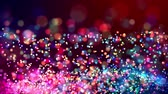 glitter magic multicolored particles fly and glow in viscous liquid with amazing shining bokeh for festive background in 4k. Close-up shot with luma matte as alpha channel. 70 Stock mozgókép