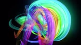 Motion graphics 3d looped amazing background with multicolor colorful rainbow ribbons. Transparent colored lines with a neon glow on a black background.