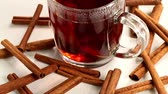 koflík na čaj : spices fresh cinnamon sticks and a cup of hot strong black tea