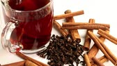 spiced : a cup of hot black tea and cinnamon sticks with dried cloves