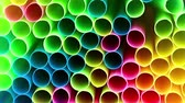 několik : the neatly stacked multi-colored plastic pipes