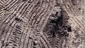 drifting : traces of car tires on heavy viscous earth Stock Footage