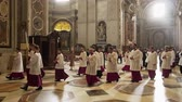 vaticano : VATICAN- APRIL 2018: cardinals and priests march in the cathedral of St. Peters Basilica, Vatican, Italy Vídeos