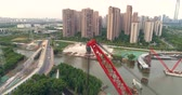 Aerial view of floating crane, pedestrian bridge construction