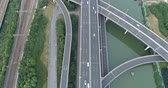 carrier : Aerial drone flight over evening road traffic. Two-level road junction. Top view. 4K Stock Footage
