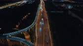 carrier : Aerial drone flight over night road traffic. Two-level road junction. Top view. 4K