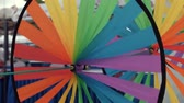 pinwheel : Close-up of rotating rainbow colored windmills Stock Footage
