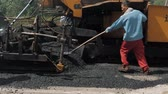 urban renewal : 19 August 2018. Suzhou, China. Pavement machine laying fresh asphalt during highway construction